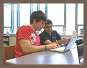 students working together with chromebook