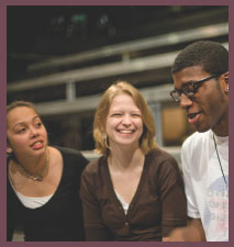 three students laughing together