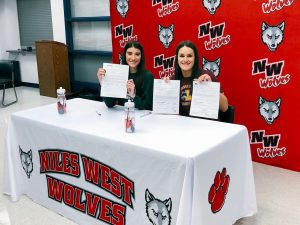 Two Niles West athletes signed letters of intent to compete in college.