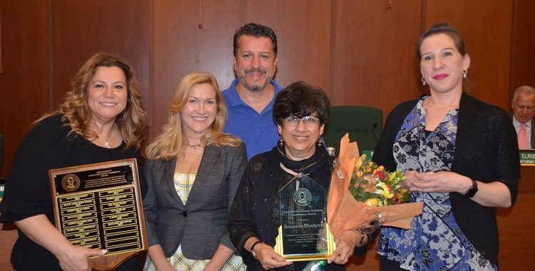 Group photo receiving award Rosamin Bhanpuri (center) is the Lincolnwood Human Relations Commission's Person of the Year. Also shown, from left: Commission Chair Mary Athans, Vice-Chair Wynne Terlizzi, Mario Rizzotti and Jennifer Costantino.