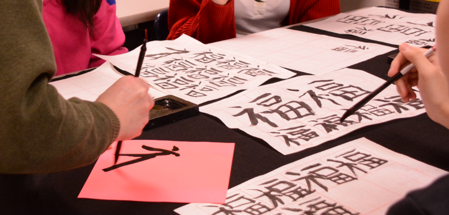 Chinese Artist gives lesson in Calligraphy to Niles North class