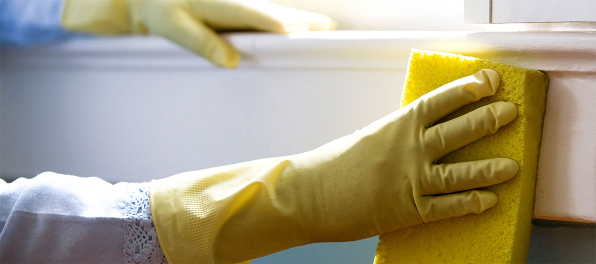 cleaning with sponge and rubber gloves
